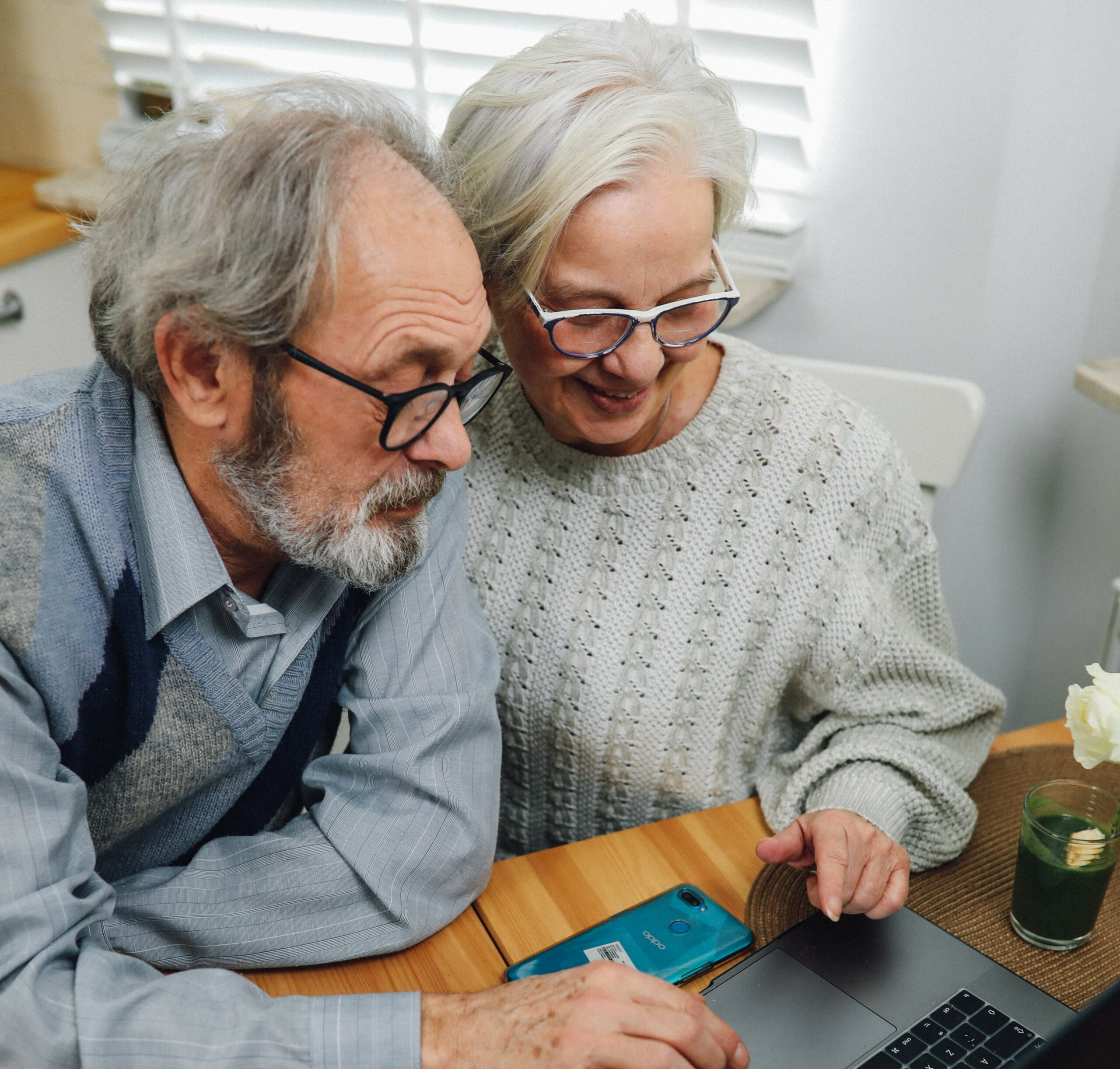 Old couple typing